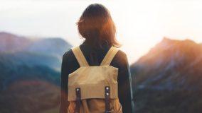 header-backpack-mountains-girl